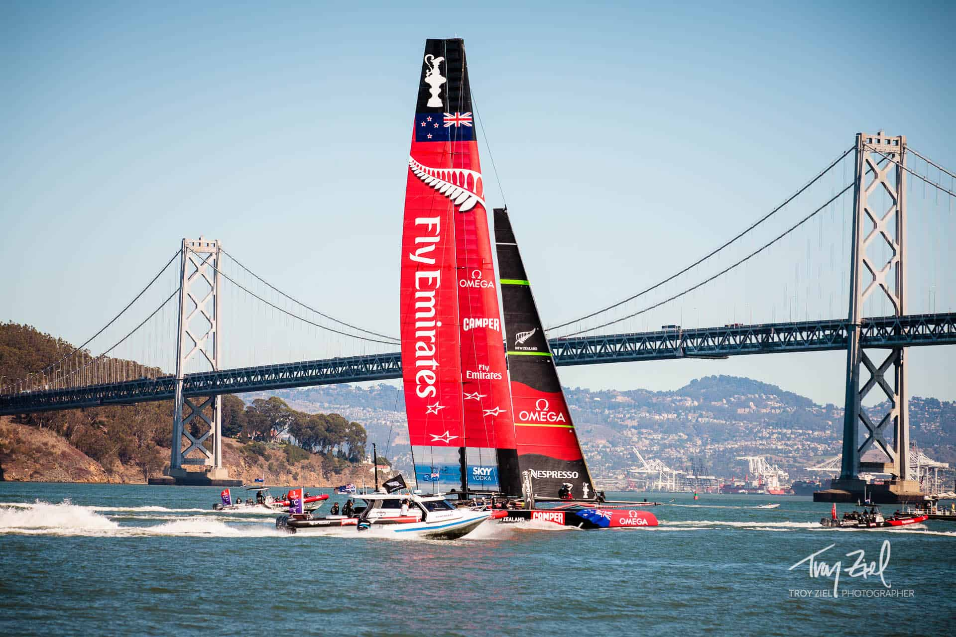 America's Cup Emirates Boat, in the San Francisco Bay, with the Bay Bridge in the background.