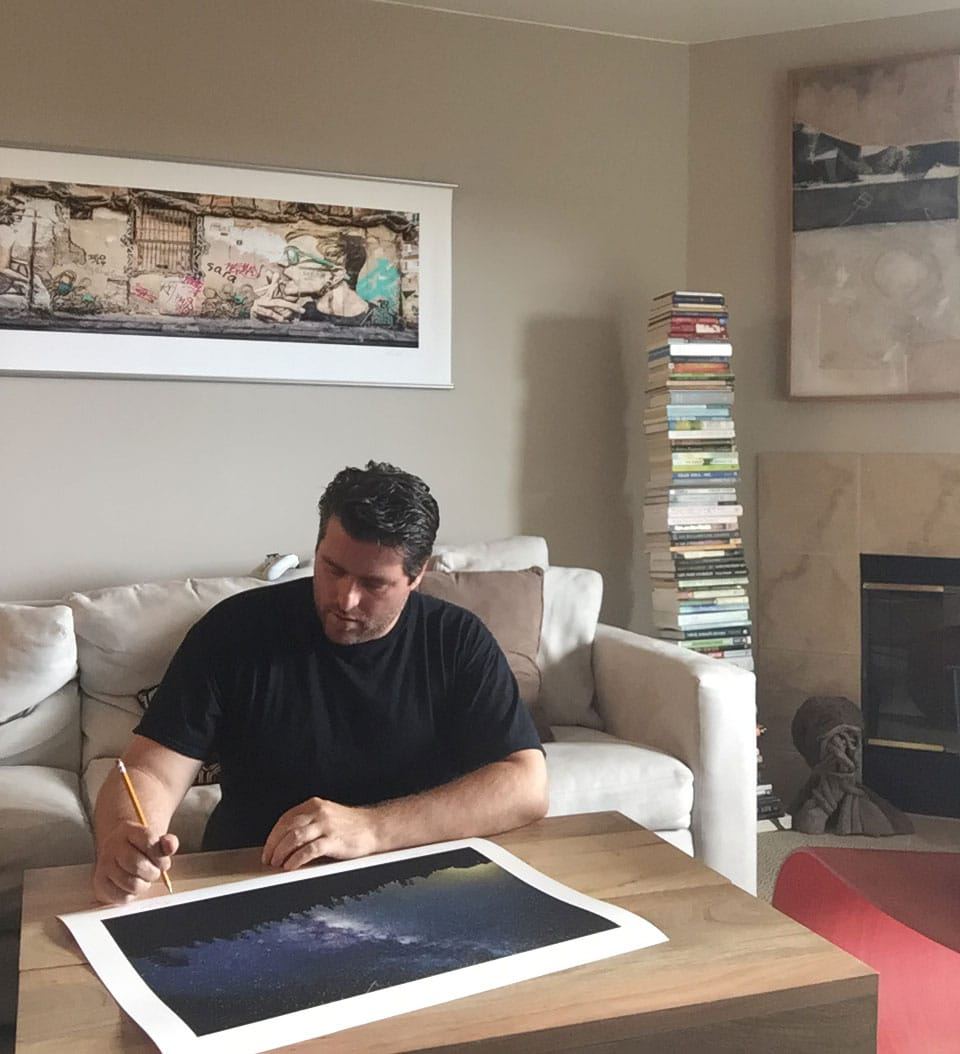 Troy Ziel signing a print